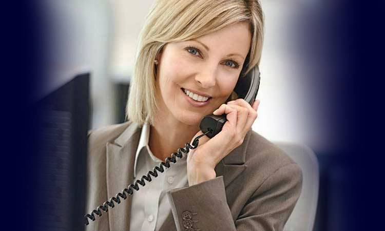 woman in a suit on the phone